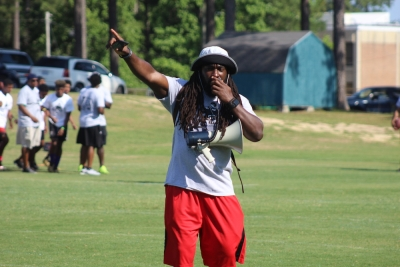 Two-time Super Bowl champion Dannell Ellerbe calls out instructions during his seventh annual USA Football FUNdamentals camp Saturday.