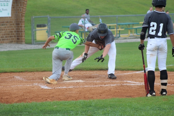 Caleb Talton (35) tags a runner out at the plate during Thursday's 15-9 win over Pinecrest.