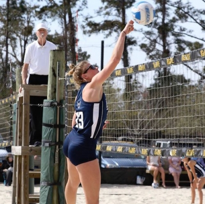 Former RSHS volleyball player Altman Griffin competes in a UNCW beach volleyball match this spring.