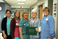 Bradshaw (holding award) with (left to right): Deana Kearns, Ronda Staimpel, Tammy Stafford, and Scarlett Blue