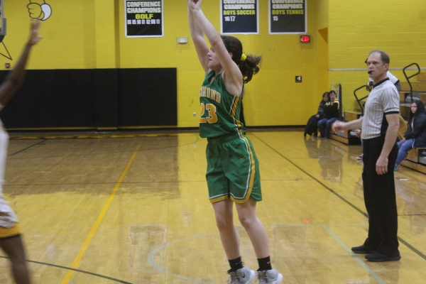 Junior Layne Maultsby (23) pulls up for one of her team-high three three-pointers Thursday, as she scored a season-high nine points off the bench.