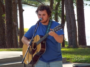 RichmondCC student Taylor Bowersock, 19, plays at the lakeside amphitheater on the college's campus in the second installment of the Live @the Lake concert series.