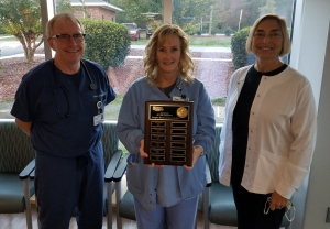Pictured with Amy Butler (center) is James O. Lewis, M.D. and Allison Duckworth, R.N.