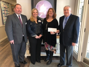 "Watson-King Funeral Home is sponsoring the ""Cool Cars for a Cause"" car show on March 30 to benefit Richmond County Hospice. Pictured, from left: Chad Woody, Kristina Leyden, Julia Woody and Jackie Hatfield."