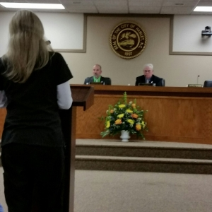 Hamlet resident Johnnie Butterfield addresses Hamlet City Council (flowers in memory of Earl Bradshaw)