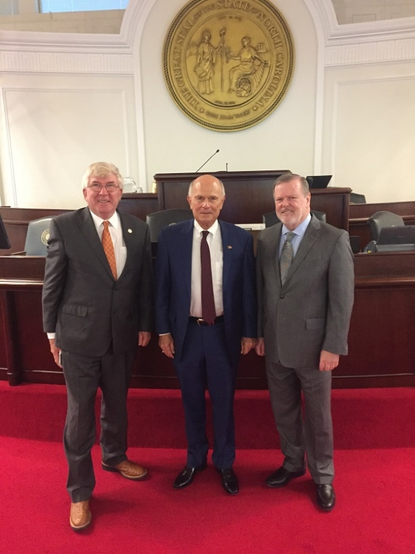 Rockingham Dragway owner Steve Earwood, center, stands flanked by Sen. Tom McInnis, R-Richmond, and Sen. Phil Berger, R-Rockingham, after being recognized by the N.C. Senate.