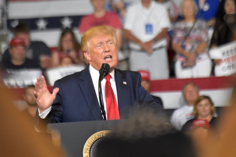 President Donald Trump speaks to a crowd of supporters during a rally at East Carolina University on Wednesday.