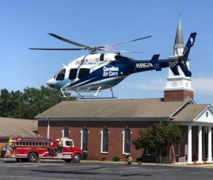A medical chopper from UNC Hospital lands in the parking lot of Beverly Hills Baptist Church early Friday afternoon to airlift a crash victim.