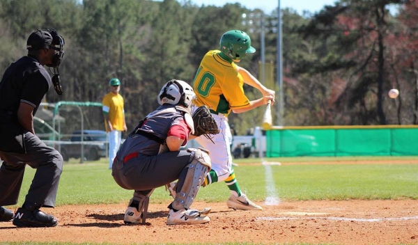 Junior Dallas Cowick connects for a 2-RBI double in the second inning of Saturday's win.