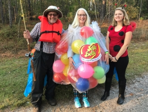 Tim Smoot, Dr. Angie Adams and Ana Auman at RCC's Trick-or-Treat on the Trail.