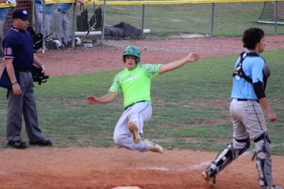 Rising senior Garret Richardson slides home safely in the fourth inning during Richmond's 13-3 win over Union Pines.