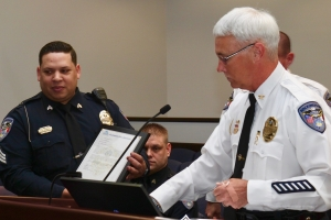Rockingham Police Chief Billy Kelly presents the Life Saving Award to Sgt. C.E. Revels at Tuesday's City Council meeting.