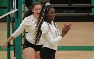 Jakerra Covington (7) and Taylor Chappell celebrate after a point in the third set of Wednesday's win.