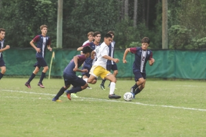 Senior forward Carlos Alcocer weaves between several CATA defenders during Wednesday's 3-1 victory.