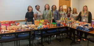 Richmond County health and human services employees stand behind the bounty collected for the DSS food pantry.