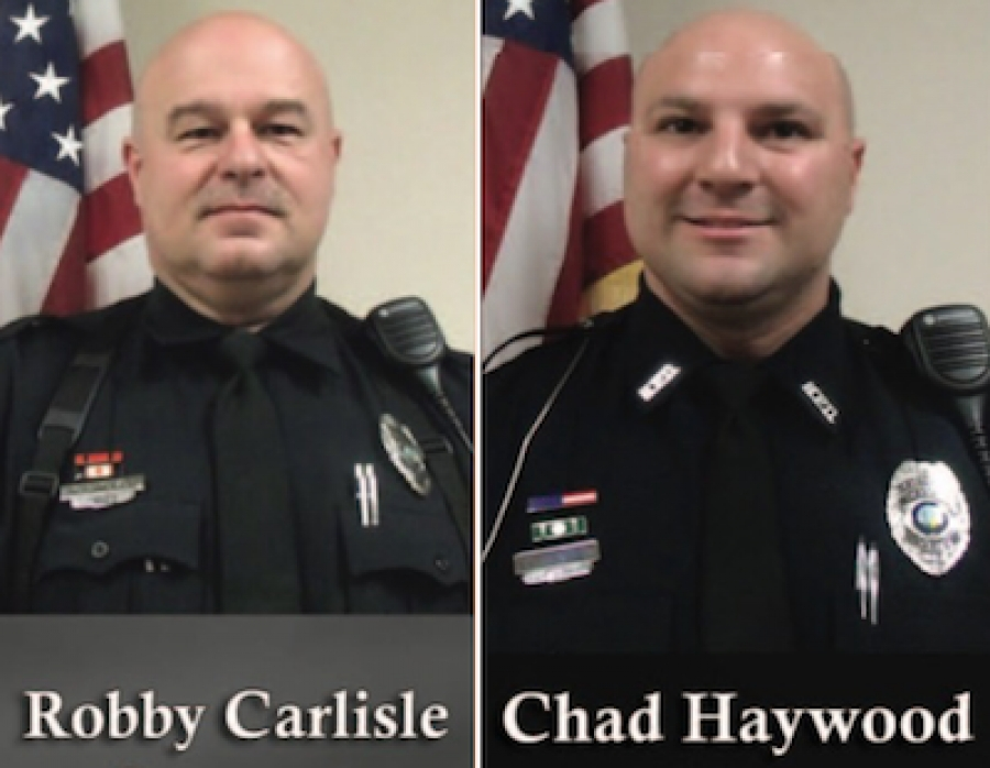 Officers Robby Carlisle (left) and Chad Haywood (right) were recently awarded certificates of achievement.