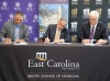 (From left) Dr. Ronny Bell, chair of ECU's Department of Public Health, UNC-Pembroke Chancellor Dr. Robin Gary Cummings and Dr. Mark Stacy, dean of ECU's Brody School of Medicine, sign a memorandum of understanding on Dec. 6, 2018 to formalize a public health partnership between the two schools.