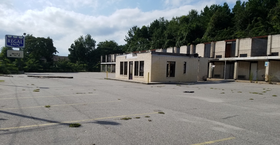Owners of the former Regal Inn property have another month to clean up before the city steps in.