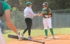 Freshman Sydney Smith high-five coach Jordan Fortune following a triple in Monday's loss to Anson.