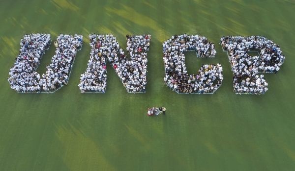 Freshmen at UNC Pembroke spell out the college's initials. The college announced a record enrollment of record enrollment  of 7,698 for 2019.