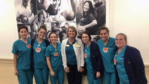 Richmond Community College nursing graduate Nina Williams stands in the middle of a group of University of North Carolina-Wilmington nursing students. Williams is a professor at UNCW.