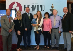 Members of the Robinette family, including Kenneth and Claudia (center), unveiled their Lois Smith Memorial Scholarship for Future Teachers. Pictured left to right: Dr. Hal Shuler, associate vice president of development for RichmondCC; Gabrielle Goodwin, daughter of the Robinettes; Kenneth Robinette; Claudia Robinette, holding grandson Grey; Pam McKay and Frank McKay; and Dr. Dale McInnis, president of RichmondCC.