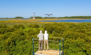 Drone spraying operations near Bodie Island Lighthouse.