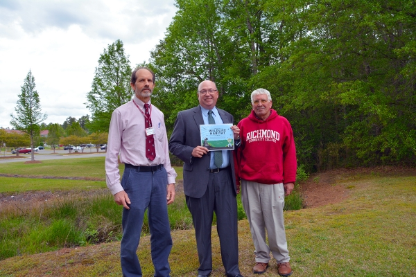 Pictured are, from left, Stephen Beck, RichmondCC biology instructor; Dr. Dale McInnis, president of the College; and Danny Thames, grounds supervisor.