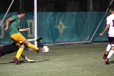 Senior Drew Davis boots his first goal of the season past Jackson Davis in the 58th minute of Wednesday's match.