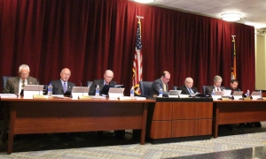 County Commissioners review audit of last fiscal year's financial statements during Tuesday's monthly meeting.