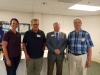 Pictured L-R  Carly Little (Governor's Assistant),Bill Burnham (Governor's Aide), Scott Van Der Linden (District Governor), George Stone (President of Rockingham Rotary Club)