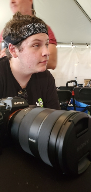 Jordan Lester takes a break from photographing bands at Epicenter Festival in May. The 16-year-old has been freelancing movie and music reviews for the Dunn Daily Record since he was 12.