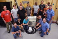 Richmond Community College students in the Air Conditioning, Heating and Refrigeration Technology program stand with the Daikin ductless mini split heat pump donated by Hoffman and Hoffman.