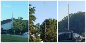 A parent says she snapped these three photos Friday morning of flagpoles bearing no flags Friday morning.