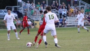 Richmond Observer File Photo: Sophomore Noah Jordan (15) in action earlier this season against Seventy-First. He scored one of Richmond's four goals in Monday's win.