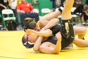 Sophomore Carson Jordan pins Austin Woods in the 138-pound match during Wednesday's senior night.