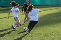 Juniors Carley Lambeth (left) and Kelsey Sheffield (right) contest for the ball during practice last week.