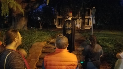 Scott Tomestic of Pee Dee Region Paranormal tells a group of tour takers about reported ghost sightings at the Leak-Wall House.