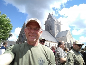 Jon Ring stands outside the church at Saint Maire Eglise.