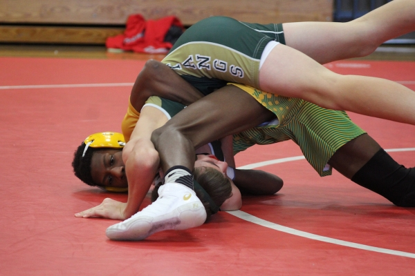 Joseph Nicholson (yellow headgear) became the fastest Raider to 100 career wins with his pin against North Moore's Landon Hussey.