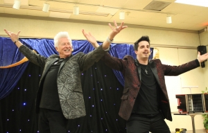 Chris Bays and Neal Chamberlain of Rockstar Magic perform at Leath Memorial Library on Monday.