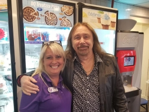 Jonna Carter poses with Judas Priest bassist Ian Hill at the Rockingham Dairy Queen during Saturday's storm. The band was scheduled to perform that night at the inaugural Epicenter Festival, but severe weather led to an evacuation and eventual cancellation of the rest of the day's performances.