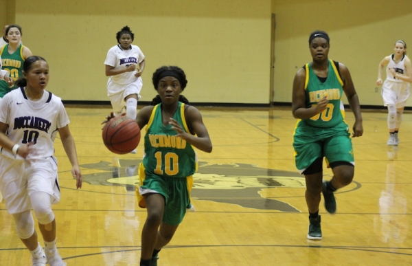 Freshman Jayla McDougald charges down the court en route to netting two of her 11 points in her varsity debut. She was called up from the junior varsity team for Monday's SAC tournament game at Jack Britt.