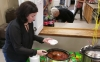 Hamlet Senior Center Director Sarah Locklear spoons a ladle of chili for a judge for the third annual Chili Cook-off. Locklear's chili won the contest. See the Richmond Observer's Facebook page for video from the event.