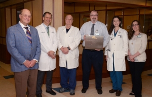 Members of the McLeod Stereotactic Radiosurgery Team include, from left, Dr. T. Rhett Spencer, radiation oncologist; Dr. William Naso, neurosurgeon; Dr. Larry Grubb, radiation oncologist; Tobin Hyman, chief medical physicist; Dr. Virginia Clyburn-Ipock, radiation oncologist; and Lisa Esco, medical physicist.