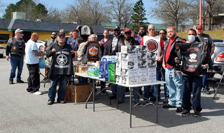 Members of several motorcycle and riding clubs gave out food to the Richmond County homeless population Sunday.