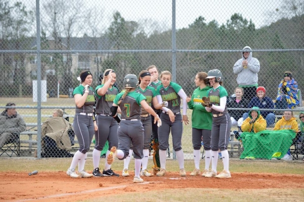 Payton Chappell (7) trots toward her teammates at home plate after crushing her first career home run during the second inning of Tuesday's 6-1 win over Jack Britt.