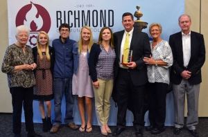 Brett Deaton was the recipient of the 2017 Richmond Community College Outstanding Alumni Award. He stands with his family members who came to Convocation with him to accept the award.