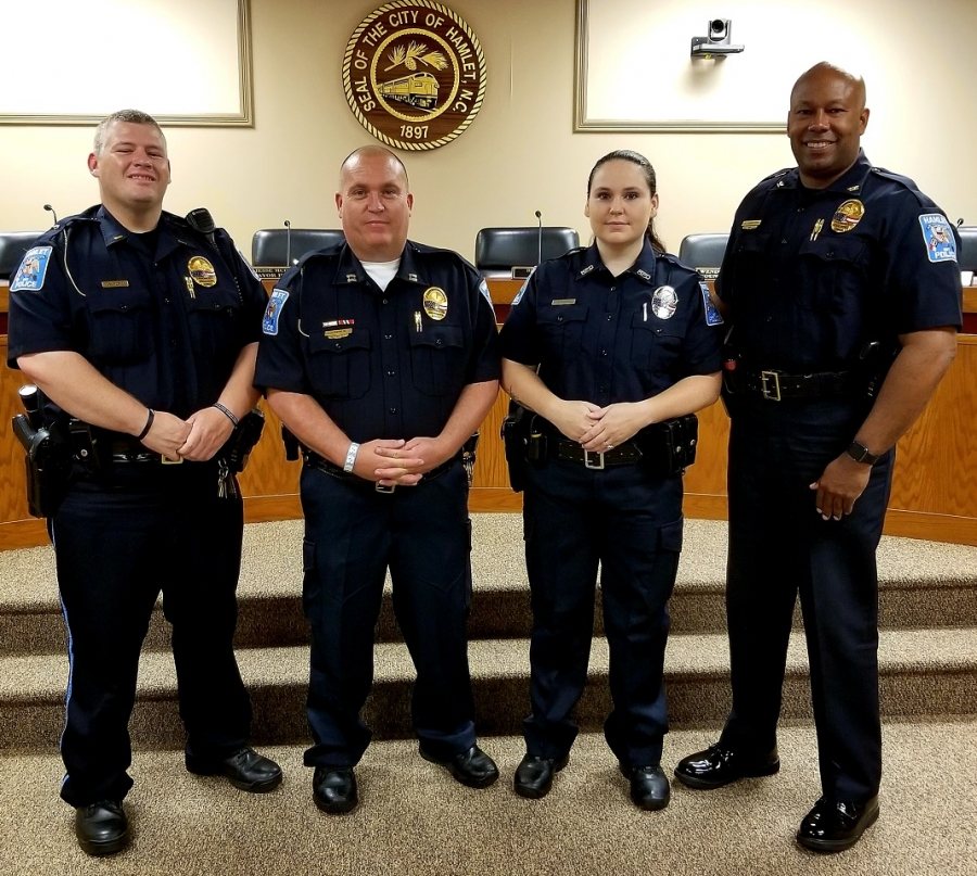 Heather Smith, second from right, was sworn in as an officer with the Hamlet Police Department on Thursday. From left, Patrol Lt. Donald Ray Morton, Capt. Randy Dover, Smith, Chief Tommy McMasters.