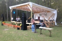 "Camp Millstone director Keith Russell welcomes guests at the inaugural ""Pickin' in the Pines"" event in Ellerbe Saturday."